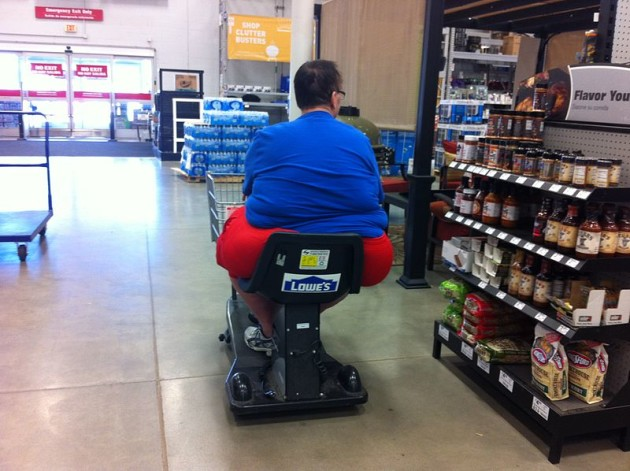Obese_Man_in_Motorized_Cart_at_Lowe's